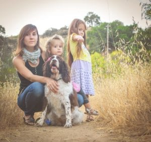 Family Picture with a springer spaniel